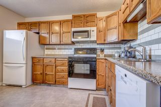 Photo 3: 14 5625 Silverdale Drive NW in Calgary: Silver Springs Row/Townhouse for sale : MLS®# A1153213