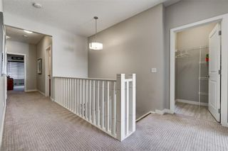 Photo 33: 129 HEARTLAND Way: Cochrane House for sale : MLS®# C4170251