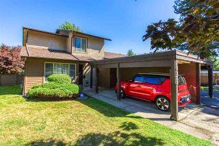 """Photo 1: 6928 134 Street in Surrey: West Newton 1/2 Duplex for sale in """"BENTLEY"""" : MLS®# R2490871"""
