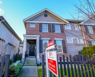 """Photo 1: 1 6885 208A Street in Langley: Willoughby Heights Townhouse for sale in """"Milner Heights"""" : MLS®# R2019684"""