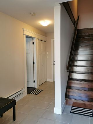 "Photo 4: 115 3333 DEWDNEY TRUNK Road in Port Moody: Port Moody Centre Townhouse for sale in ""CENTREPOINT"" : MLS®# R2561726"