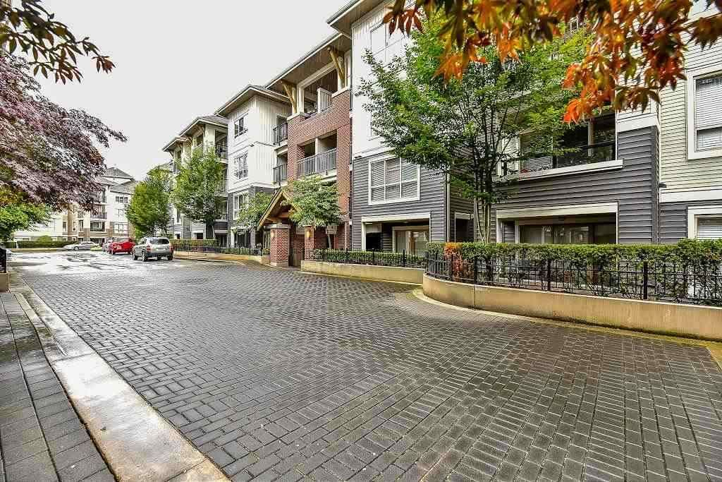 "Main Photo: A401 8929 202 Street in Langley: Walnut Grove Condo for sale in ""The Grove"" : MLS®# R2108220"