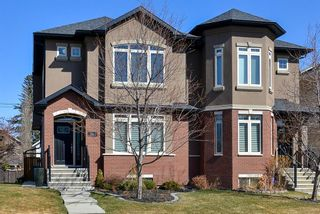 Photo 1: 1612 17 Avenue NW in Calgary: Capitol Hill Semi Detached for sale : MLS®# A1090897