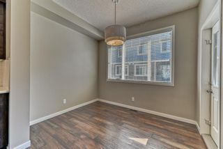 Photo 10: 539 Panatella Walk NW in Calgary: Panorama Hills Row/Townhouse for sale : MLS®# A1125854