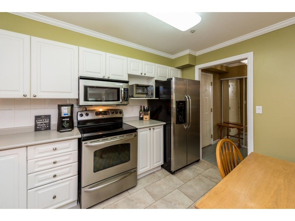 """Photo 8: Photos: 201 9626 148TH Street in Surrey: Guildford Condo for sale in """"Hartfood Woods"""" (North Surrey)  : MLS®# R2329881"""