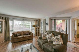 Photo 4: 304 9962 148 Street in Surrey: Guildford Condo for sale (North Surrey)  : MLS®# R2080305