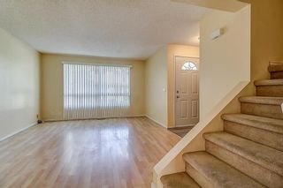 Photo 3: 145 WOODSMAN Lane SW in Calgary: Woodbine Row/Townhouse for sale : MLS®# C4303483