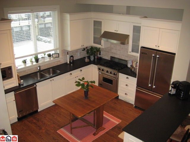 """Main Photo: 423 2580 LANGDON Street in Abbotsford: Abbotsford West Townhouse for sale in """"THE BROWNSTONES ON THE PARK"""""""