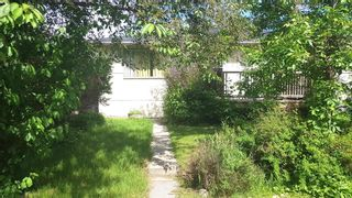 Photo 2: 1438 39 Street SW in Calgary: Rosscarrock Semi Detached for sale : MLS®# A1087813