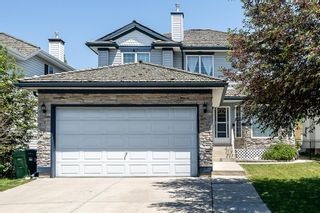 Main Photo: 66 Springbank Crescent SW in Calgary: Springbank Hill Detached for sale : MLS®# A1124288