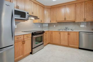 Photo 3: 3103 Hawksbrow Point NW in Calgary: Hawkwood Apartment for sale : MLS®# A1067894
