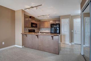 Photo 5: 1208 92 Crystal Shores Road: Okotoks Apartment for sale : MLS®# A1089465