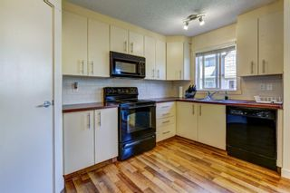 Photo 15: 504 2445 KINGSLAND Road SE: Airdrie Row/Townhouse for sale : MLS®# A1017254