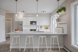 Photo 1: 111 100 Auburn Meadows Manor SE in Calgary: Auburn Bay Apartment for sale : MLS®# A1040865