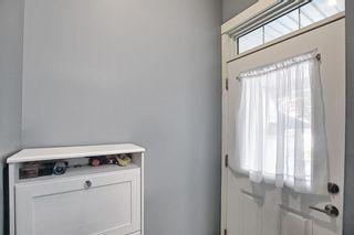 Photo 7: 504 281 Cougar Ridge Drive SW in Calgary: Cougar Ridge Row/Townhouse for sale : MLS®# A1123514