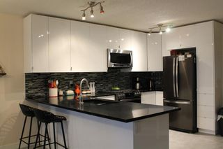 Photo 3: 201 Valarosa Place: Didsbury Detached for sale : MLS®# A1085244