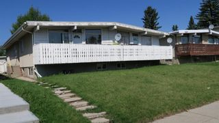 Main Photo: 2609 & 2611 39 Street SE in Calgary: Forest Lawn Duplex for sale : MLS®# A1129197