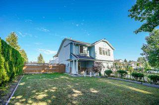 Photo 1: 9044 136B Street in Surrey: Bear Creek Green Timbers House for sale : MLS®# R2396586