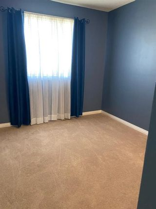 Photo 14: 554 STRATHCONA Drive SW in Calgary: Strathcona Park Semi Detached for sale : MLS®# A1020759
