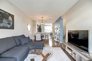 Photo 11: 1103 125 Panatella Way NW in Calgary: Panorama Hills Row/Townhouse for sale : MLS®# A1143179