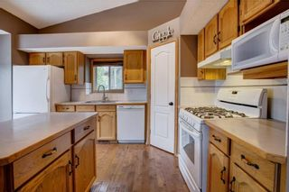 Photo 9: 152 ARBOUR RIDGE Circle NW in Calgary: Arbour Lake House for sale : MLS®# C4137863
