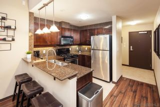 Photo 2: DOWNTOWN Condo for sale : 1 bedrooms : 1240 India Street #104 in San Diego