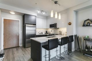 Photo 3: 1406 95 Burma Star Road SW in Calgary: Currie Barracks Apartment for sale : MLS®# A1134352