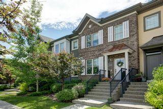 Photo 1: 340 Quarry Park Boulevard SE in Calgary: Douglasdale/Glen Row/Townhouse for sale : MLS®# A1123884