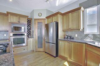Photo 11: 60 Gleneagles Close: Cochrane Detached for sale : MLS®# A1108593