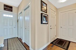 Photo 2: 744 RIVER HEIGHTS Crescent: Cochrane Semi Detached for sale : MLS®# A1026785