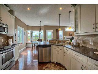 Photo 12: 33 COVEPARK Bay NE in Calgary: Coventry Hills House for sale : MLS®# C4059418