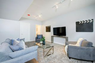 Photo 35: 32 Prominence Park SW in Calgary: Patterson Row/Townhouse for sale : MLS®# A1112438