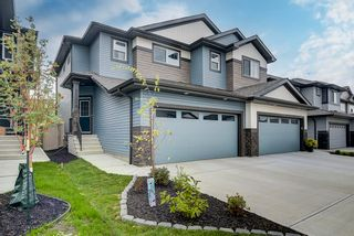 Photo 3: 235 39 Avenue NW in Edmonton: Zone 30 House Half Duplex for sale : MLS®# E4261907