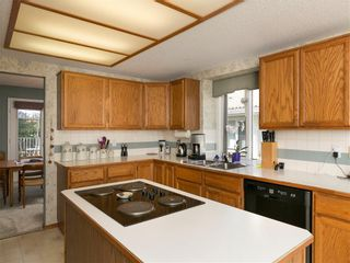 Photo 17: 33 PUMP HILL Landing SW in Calgary: Pump Hill House for sale : MLS®# C4133029