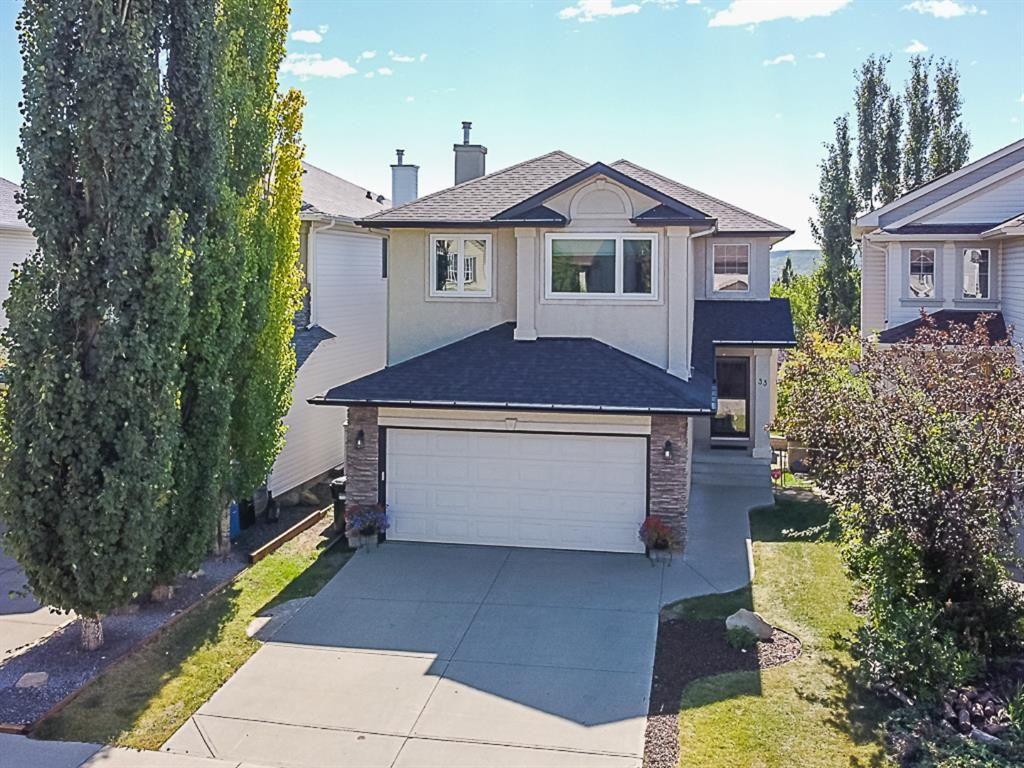 Main Photo: 33 Tuscany Meadows Common NW in Calgary: Tuscany Detached for sale : MLS®# A1083120
