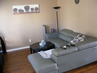 Photo 3: 202 Pinestream Place NE in Calgary: Pineridge Row/Townhouse for sale : MLS®# A1097730