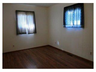 Photo 16: 204 CENTRE Avenue: Cochrane House for sale : MLS®# C4055784