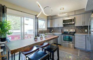 Photo 7: 246 Deerpoint Lane SE in Calgary: Deer Ridge Row/Townhouse for sale : MLS®# A1142956