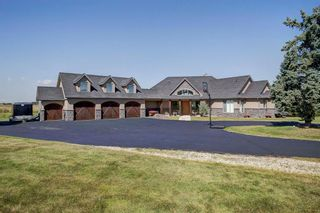Photo 1: 31180 Woodland Way in Rural Rocky View County: Rural Rocky View MD Detached for sale : MLS®# A1074858