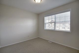 Photo 23: 25 Tuscany Springs Gardens NW in Calgary: Tuscany Row/Townhouse for sale : MLS®# A1053153