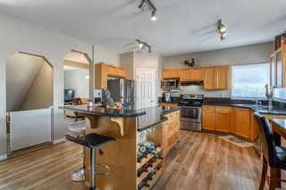 Photo 10: 32 ROCKYWOOD Park NW in Calgary: Rocky Ridge Detached for sale : MLS®# A1091115