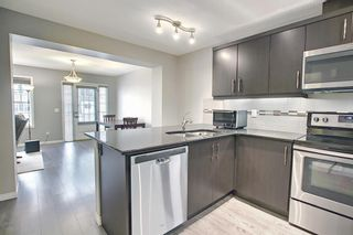 Photo 11: 309 WINDFORD Green SW: Airdrie Row/Townhouse for sale : MLS®# A1131009
