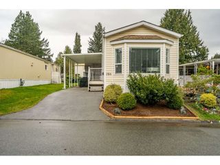 """Photo 2: 186 7790 KING GEORGE Boulevard in Surrey: East Newton Manufactured Home for sale in """"Crispen Bays"""" : MLS®# R2560382"""