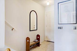 Photo 3: 203 DEERPOINT Lane SE in Calgary: Deer Ridge Row/Townhouse for sale : MLS®# C4288291
