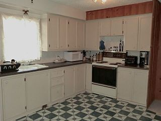 Photo 5: 208 CENTRE Avenue: Cochrane House for sale : MLS®# C4057393