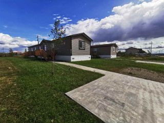 """Photo 1: 8711 74 Street in Fort St. John: Fort St. John - City SE Manufactured Home for sale in """"SOUTH ANNOEFIELD"""" (Fort St. John (Zone 60))  : MLS®# R2553301"""