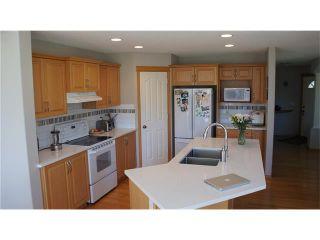 Photo 8: 100 TUSCANY RAVINE Road NW in Calgary: Tuscany House for sale : MLS®# C4030985
