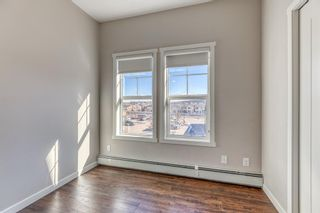Photo 16: 9308 101 Sunset Drive: Cochrane Apartment for sale : MLS®# A1079009