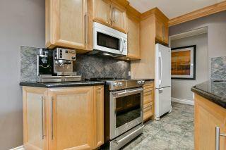 """Photo 10: 208 2493 W 1ST Avenue in Vancouver: Kitsilano Condo for sale in """"CEDAR CREST"""" (Vancouver West)  : MLS®# R2550875"""