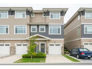 "Photo 1: 9 34230 ELMWOOD Drive in Abbotsford: Central Abbotsford Townhouse for sale in ""Ten Oaks"" : MLS®# R2386873"